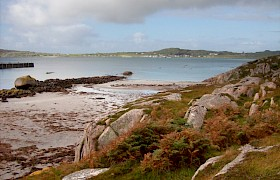 Red granite and white sand of Fionnphort Beach